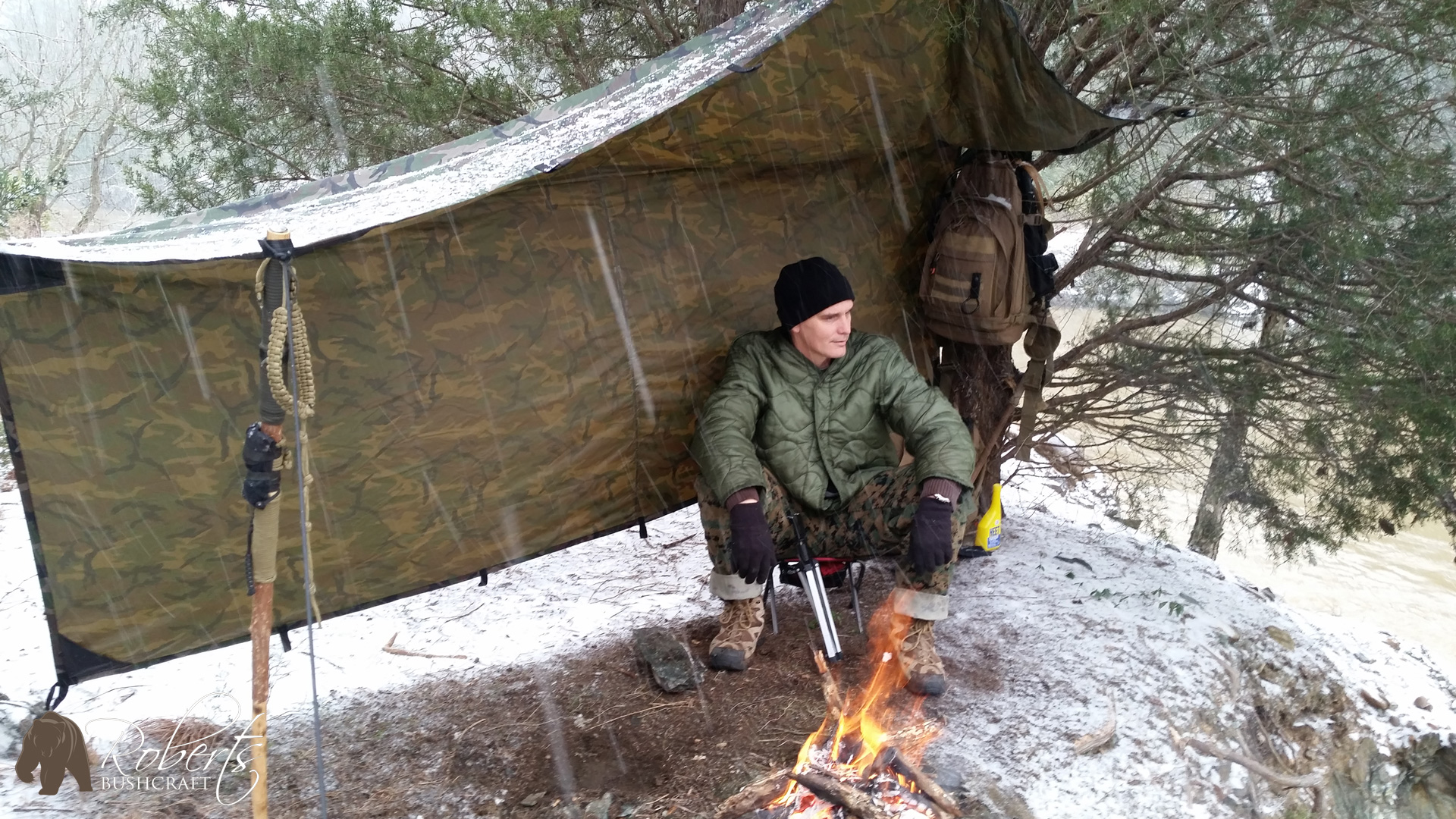 Curry Roberts of Roberts Bushcraft shelters under his Aqua Quest Defender tarp